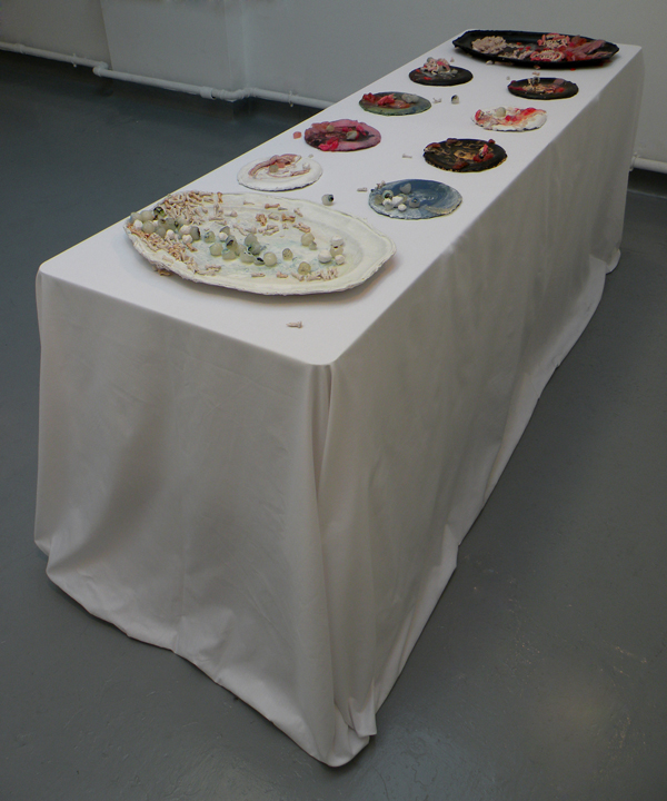 John and Medusa are Overfaced | Acrylic pieces, acrylic on aluminium and paper plates, on cotton tablecloth and table | Installation view at WW gallery, London | 2012